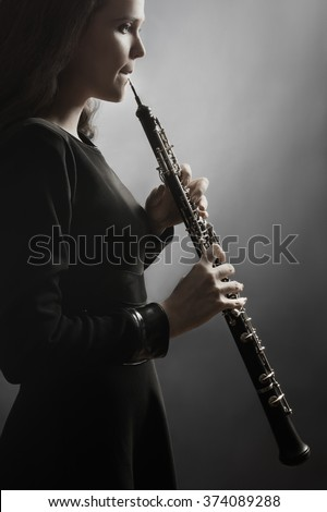 Oboe classical musician Oboist playing music instrument