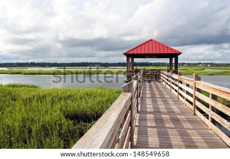 Observation and fishing pier in marshland at Hilton Head Island, South Carolina, USA. Hilton Head Island is a popular beach resort and vacation destination on the east coast of the United States.  - stock photo