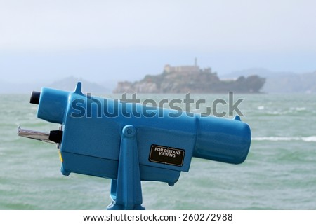 Observation coin viewer in San Francisco with Alcatraz in the background. - stock photo