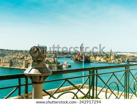 observation deck with panoramic view of Valletta, Malta and telescope in the foreground - stock photo
