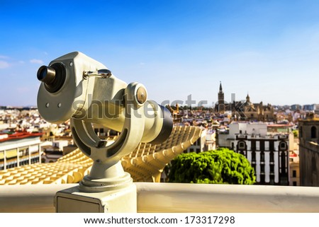 Observation monocular at Seville (on the right is the Giralda), Spain. - stock photo