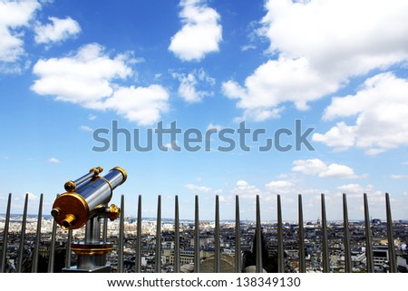 Observation telescope pointed to Paris with the beautiful summer sky background / view from the rooftop of the Arc de triomphe, Paris, France - stock photo