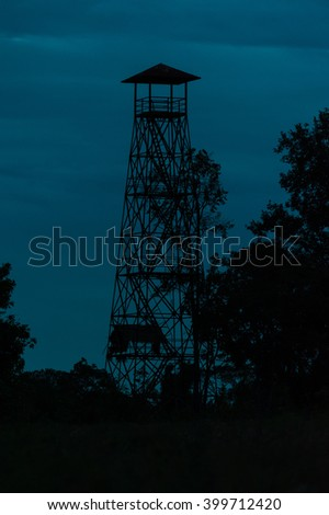 Observatory animals tower in dusk light,near forest - stock photo