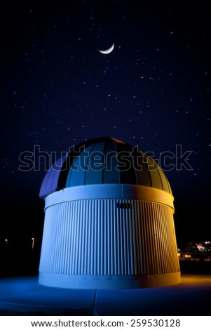 Observatory at night with crescent moon