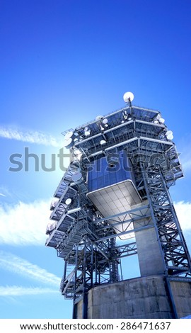 Observatory control tower structure on top of snow mountains