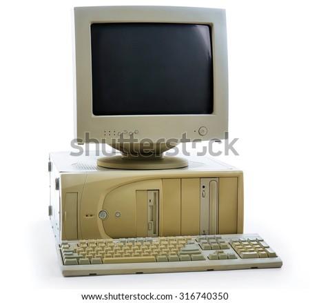 Obsolete computer set isolated on white - stock photo