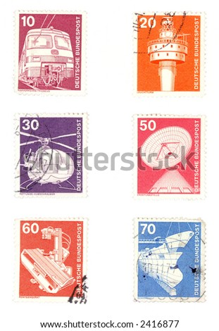 Obsolete postage stamps from Germany. Old collectible items - leisure and hobby collection. These post stamps show industrial concepts - railway and air transportation, telecommunications.