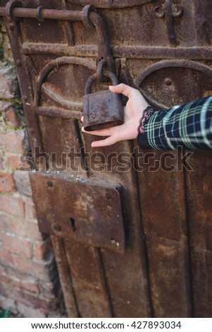 obstacle concept, hand holds a lock on the door is closed