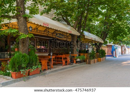 OBZOR, BULGARIA - AUG 04, 2016:  Cafe Helios near the central square. Str. Cyril and Methodius. Architecture of the town of Obzor in Bulgaria. Picture taken during a trip to Bulgaria in the morning.