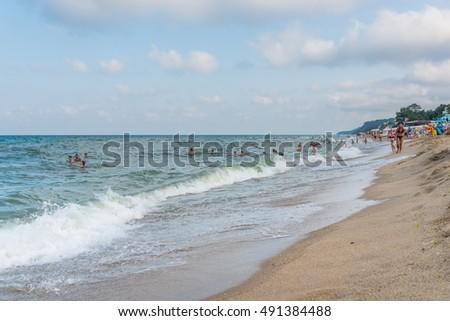 OBZOR, BULGARIA - AUG 07, 2016: City beach. People relax in the water on the shore.  Picture taken during a trip to Bulgaria.