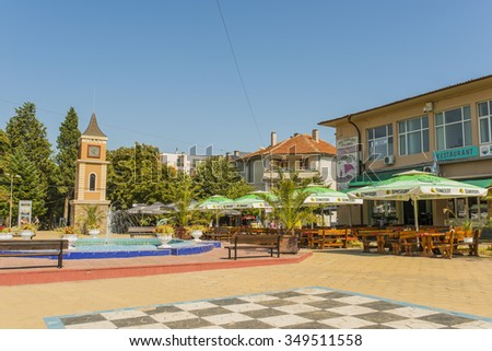 OBZOR, BULGARIA - AUG 14, 2015: City clock tower and fountain in downtown.  Architecture and streets of the town of Obzor in Bulgaria. Picture taken during a trip to Bulgaria.