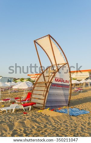 OBZOR, BULGARIA - AUG 15, 2015: Lifeguard tower. Sun beds and umbrellas on the beach.  Morning city beach in the Bulgarian town Obzor. Picture taken in the morning during a trip to Bulgaria.