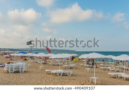 OBZOR, BULGARIA - AUG 07, 2016: Sun beds and umbrellas at the city beach. Picture taken during a trip to Bulgaria.