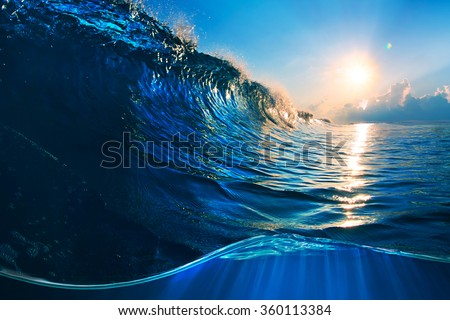 ocaen-view seascape landscape Big surfing ocean wave with slightly cloudy sky and the sun - stock photo