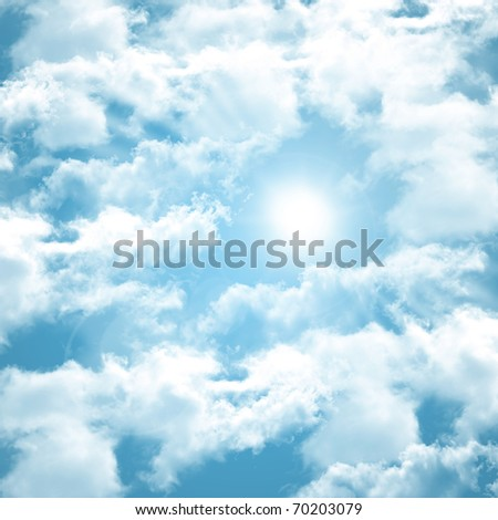 occurring white sun behind the clouds on a warm evening - stock photo
