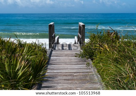 Ocean access boardwalk to Florida Beach, horizontal format. - stock photo