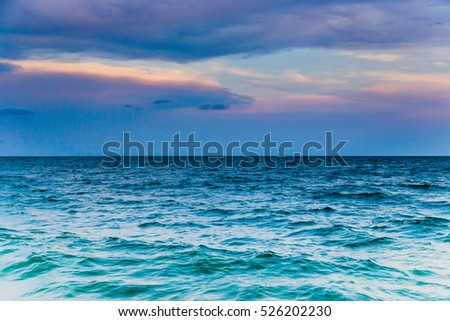 Ocean and evening sky for a background.