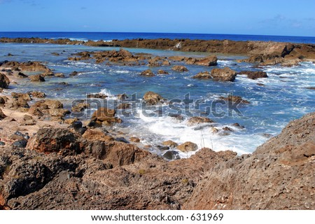 Ocean and Land at Shark's Cove at the North Shore of Hawaii. - stock photo