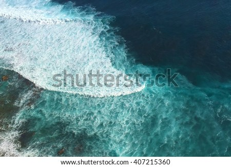 Ocean and rip curl view from abrupt cliff coast, look down from the height, Bali sea landscape, Blue waves near the tropical beach, blue waves for surfing, Indonesia, island Bali, Indonesia - stock photo
