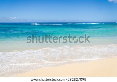 Ocean and tropical sandy beach background (Hawaii, Kauai) - stock photo