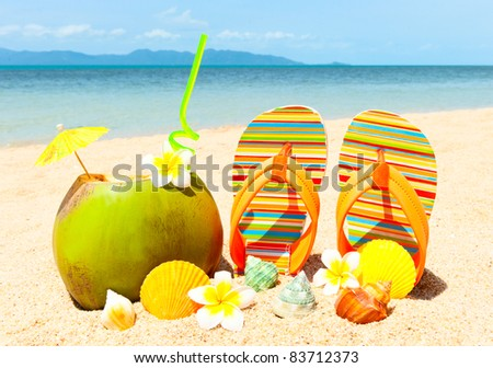 Ocean Beach with palm and and exotic coctail - stock photo