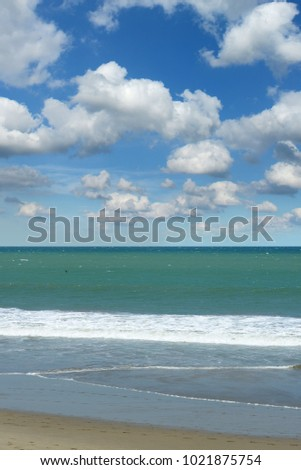 Ocean blue with blue skies on a vertical format