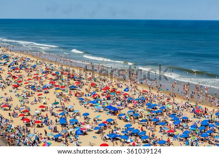 OCEAN CITY - JUNE 14: Crowded beach in Ocean City, MD on June 14, 2014. Ocean City, MD is a popular beach resort on the East Coast and one of the cleanest in the country. - stock photo