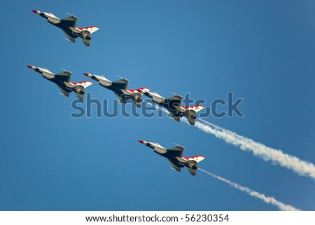 OCEAN CITY, MD - JUNE 15: US Air Force Demonstration Team Thunderbirds. Flying on f-16 showing precision of formation flying during the annual OC Air Show on June 15, 2010 in Ocean City, Maryland.