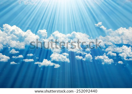 Ocean coastline, land, mountains and clouds airplane view - stock photo