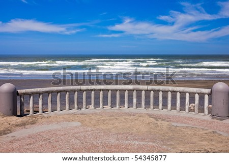 Ocean coastline landscape with railings on a foreground