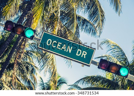 Ocean drive sign and traffic light - stock photo