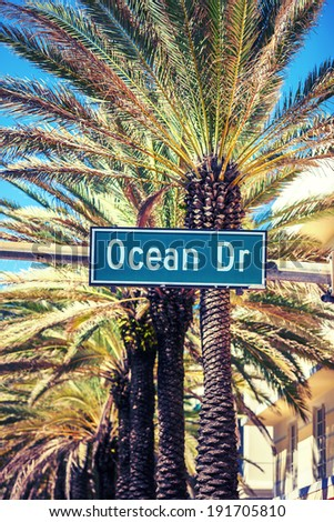 Ocean Drive street sign with palm tree in Miami Beach, special photographic processing - stock photo