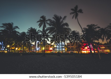 Ocean Drive street with illuminated buildings, South Beach , Florida. Vintage desaturated colors
