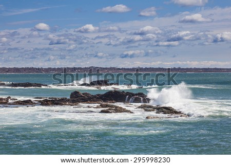 Ocean Falls at Sachuest Point.  Taken on a sunny spring day with big surf. - stock photo