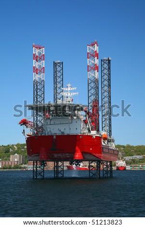 Ocean going oil rig in Halifax Harbor, Nova Scotia, Canada.  Dartmouth can be seen along the shoreline. - stock photo