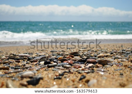 Ocean landscape. The focus in on the rocks from the beach.