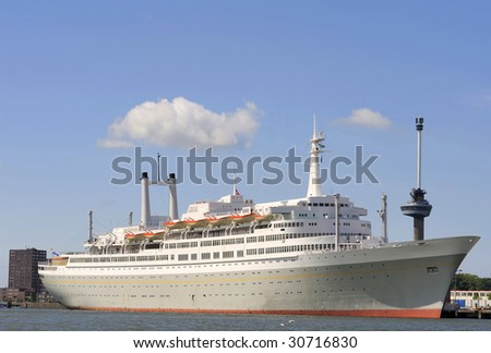 Ocean liner in the harbor of Rotterdam,Holland. At the background the Euromast Tower - stock photo