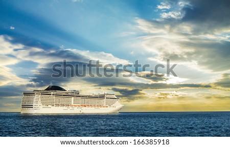 Ocean liner starting her cruise. - stock photo