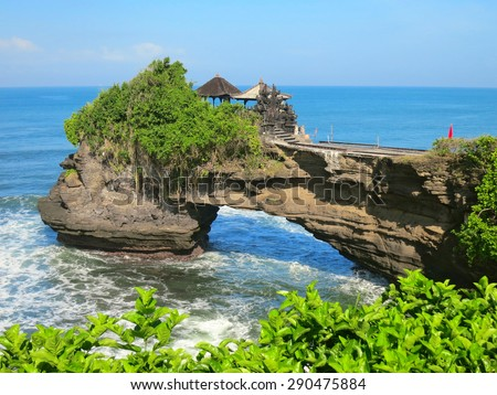 Ocean rock with hole near Pura Batu Bolong temple, Bali, Indonesia - stock photo