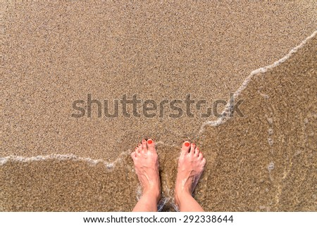 Ocean Sea Waves And Girl Feet On Summer Sand Beach - stock photo