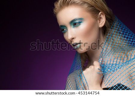Ocean secrets. Attractive young woman with a net around her shoulders wearing metallic makeup looking away mysteriously copyspace on the side - stock photo
