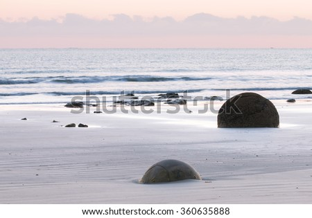 Ocean shore before sunrise.  Moeraki Boulders, New Zealand