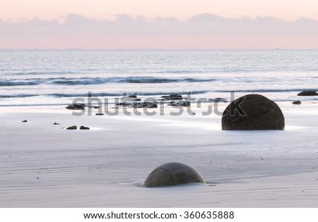Ocean shore before sunrise.  Moeraki Boulders, New Zealand - stock photo