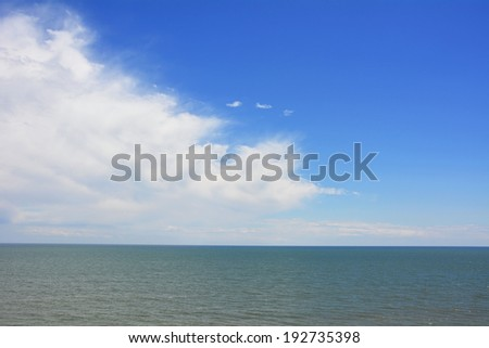 Ocean, sky and clouds - stock photo
