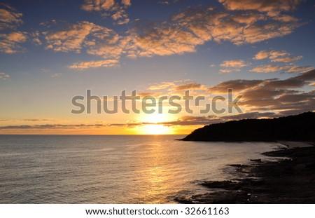 Ocean sunrise - stock photo