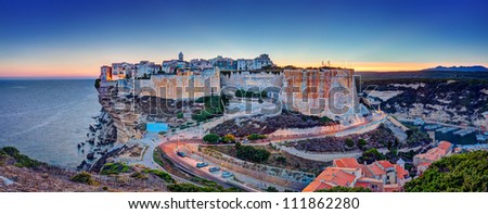 Ocean sunset in Bonifacio, a commune on the Island of Corsica in France. - stock photo