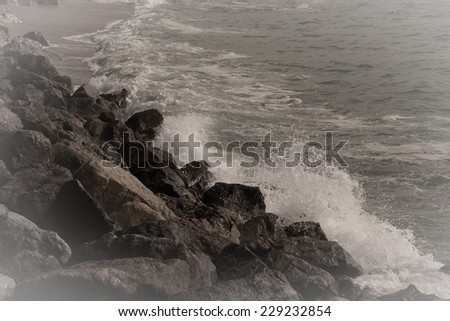 ocean surf on the coast. tinted - stock photo