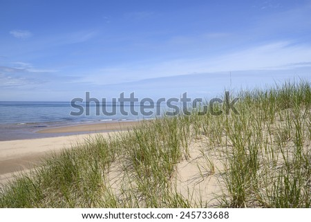 Ocean View from Sand Dunes on Sunny Day - stock photo
