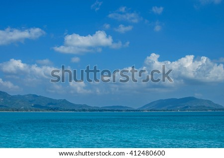 Ocean view in sunny summer day,seascape, blue sky and Island - stock photo