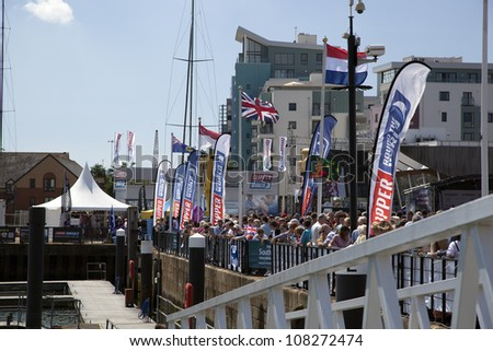 OCEAN VILLAGE, SOUTHAMPTON UK - JULY 22: Crowd await the yachts comleting the last keg of the Clipper Round the World Yacht Race,  Southampton. 22 July 2012